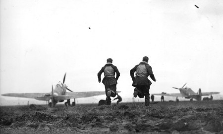 RCAF pilots run towards their waiting Hurricanes in this incredible photograph taken during the height of the Battle