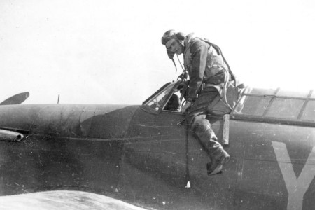 A pilot of No.1 Squadron climbs out of his plane after a sortie knowing full  well that he will be fighting in the skies again before the day is out