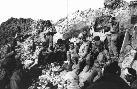 Rangers in Rudder's command post take a breather during the battle